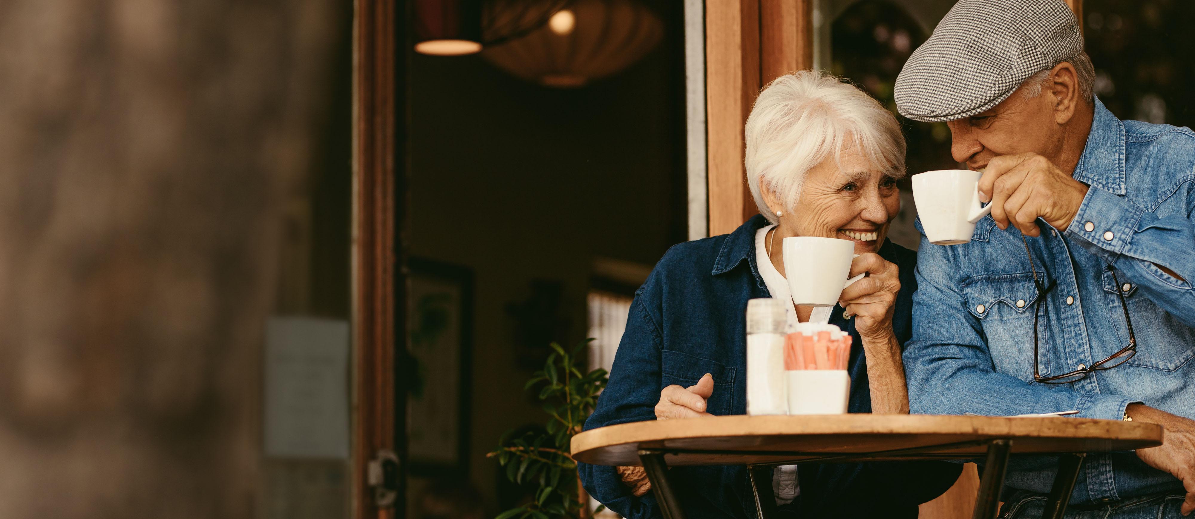 Two elderly couple drinking coffee